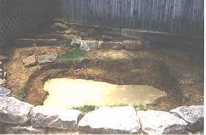 Hole dug for pond and lined with sand